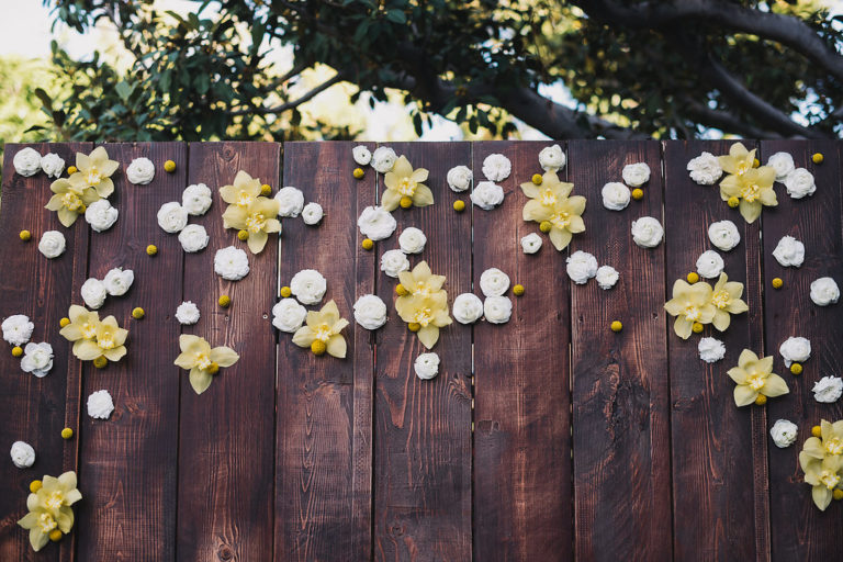 white and yellow flower wall