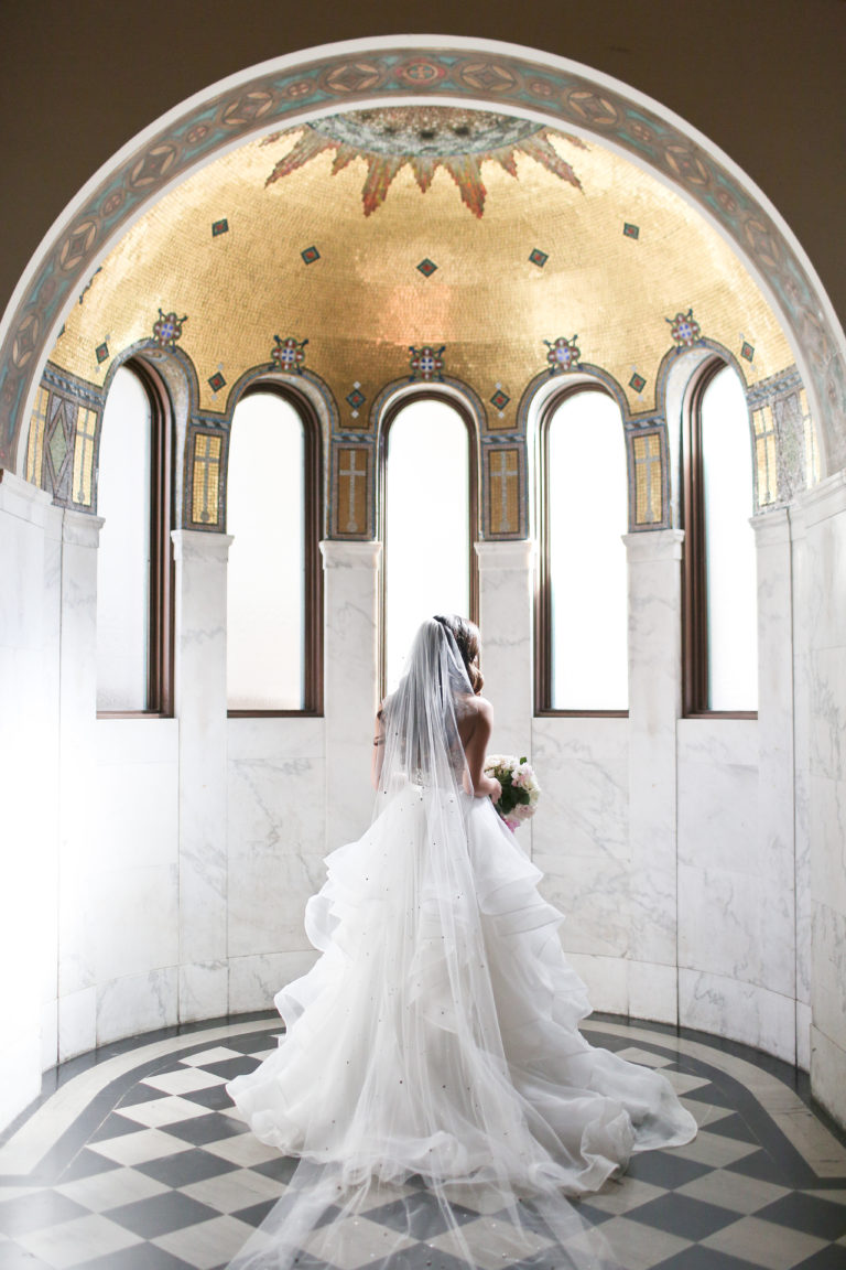 bride under gold dome at vibiana