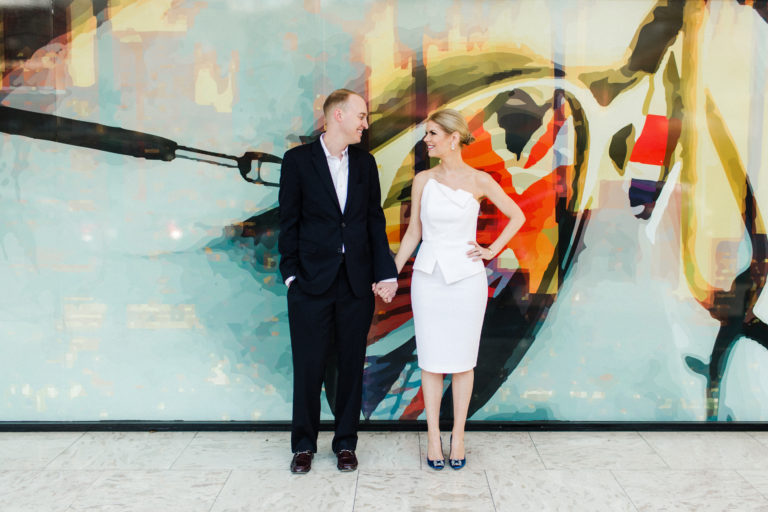couple in front of mural