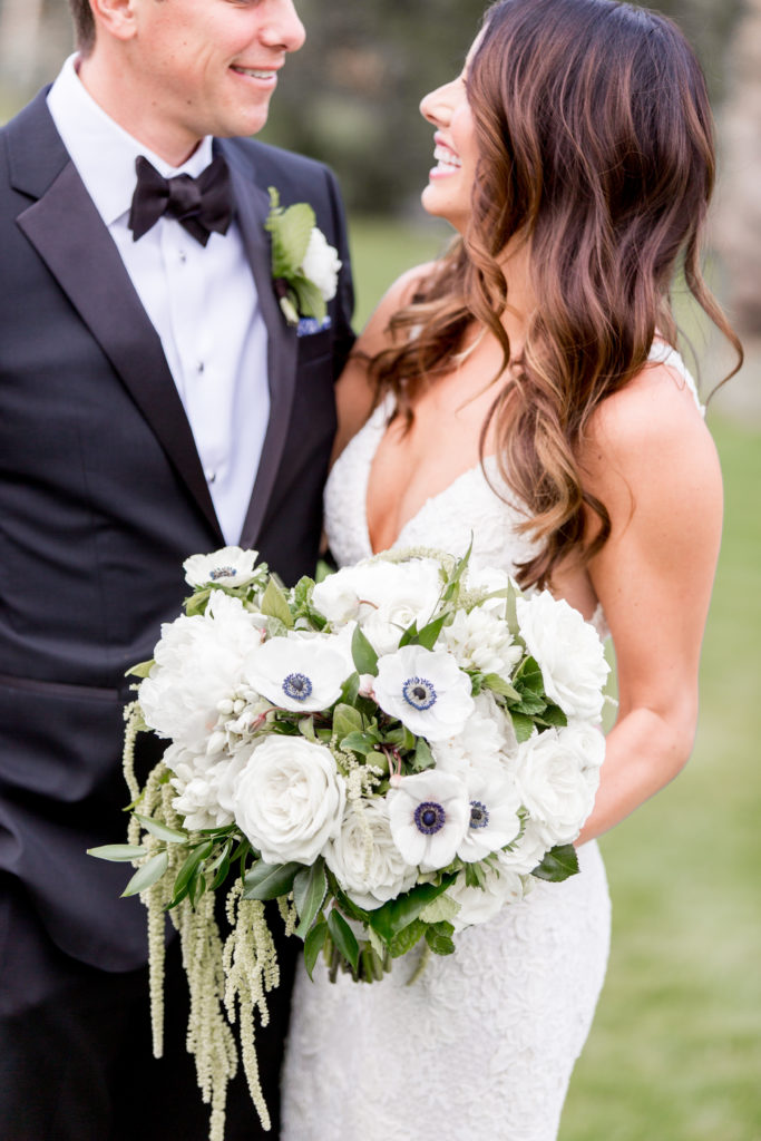 couple smiling with bouquet