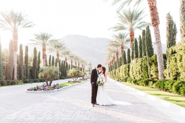 kissing in front of palm trees