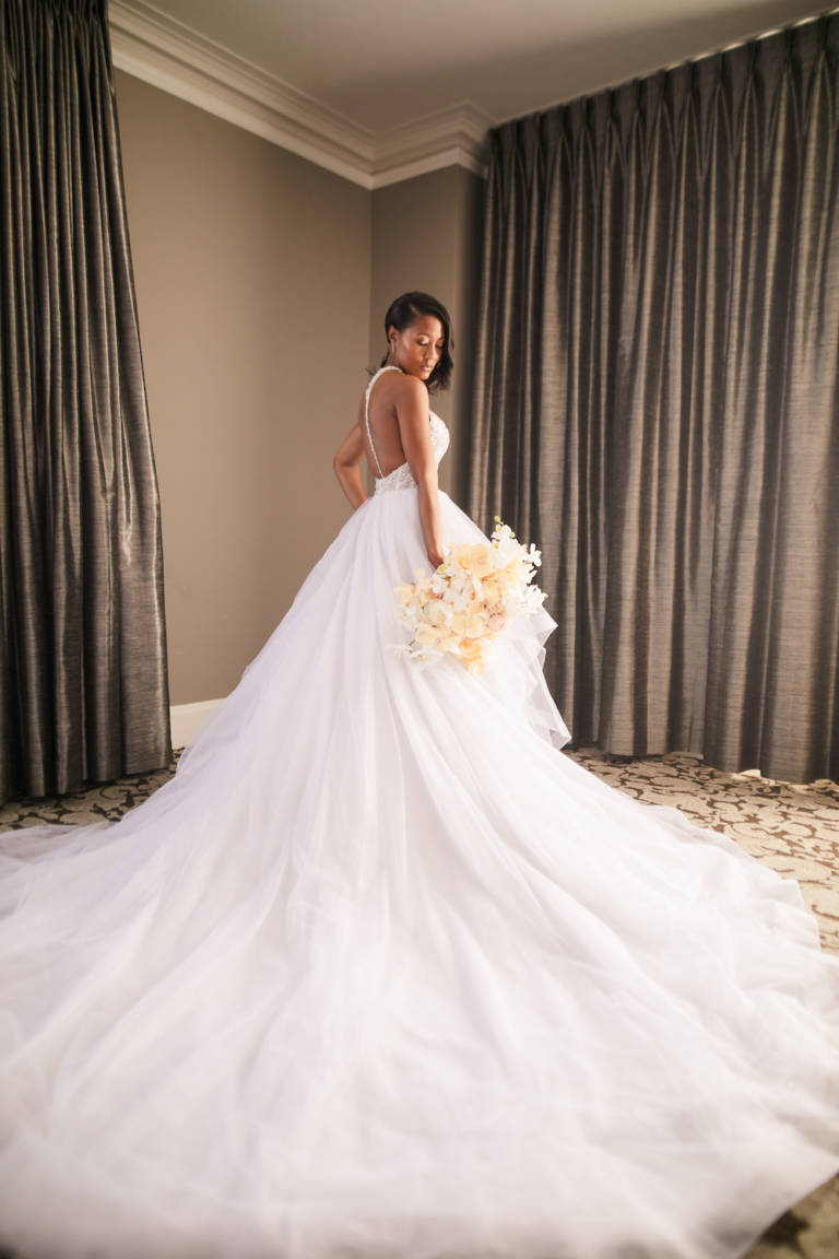 bride with wedding gown with long train
