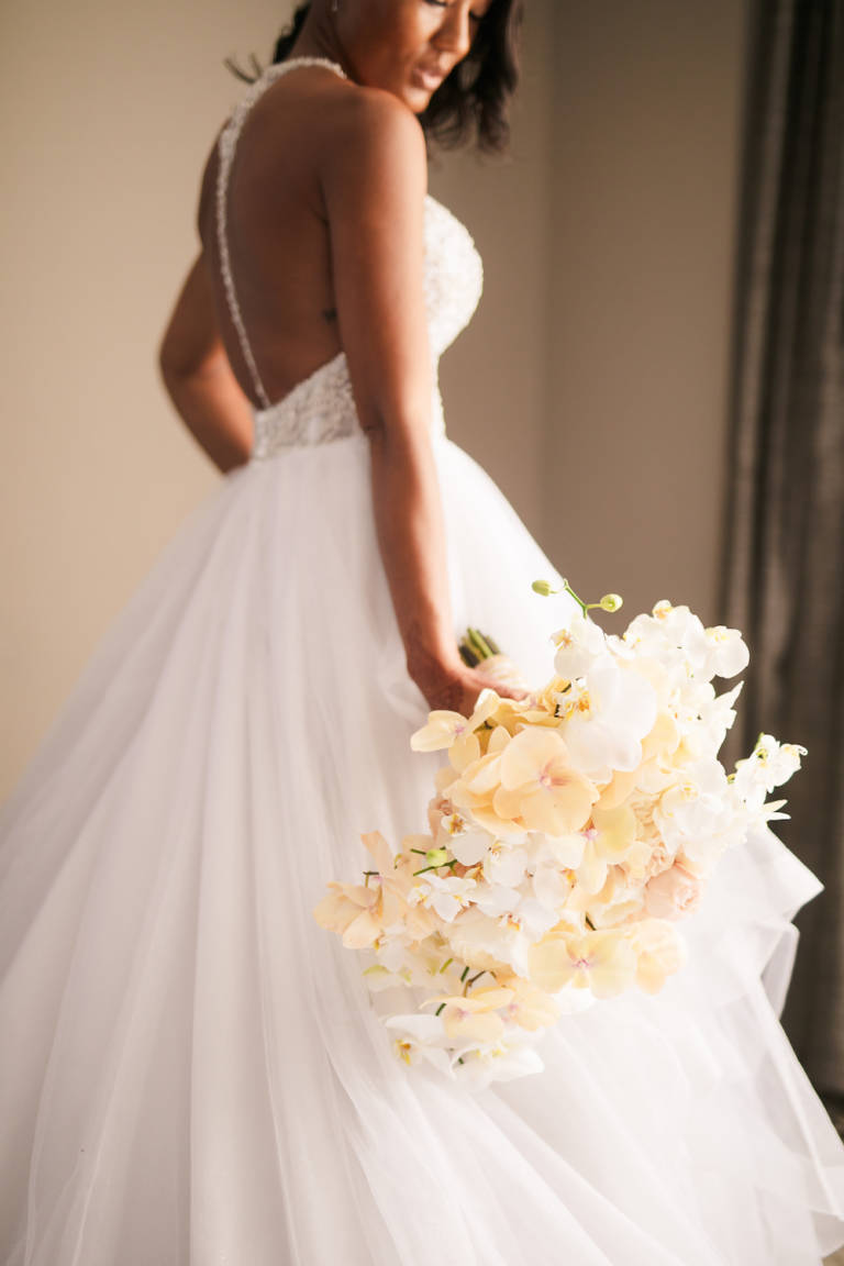bride with white floral bouquet