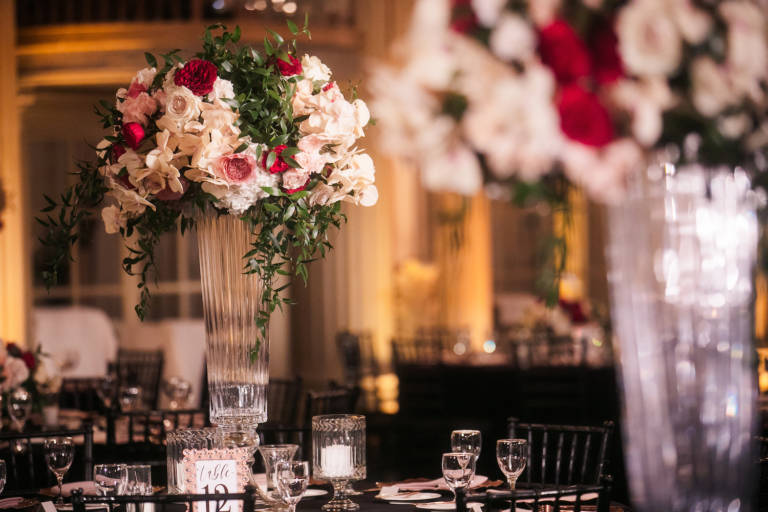 wedding table with tall vase