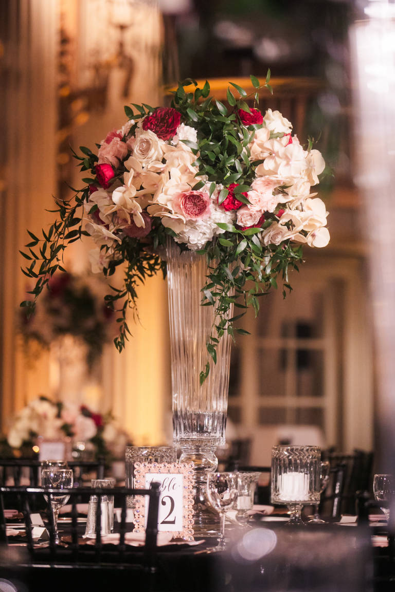 tall vase with wedding flowers
