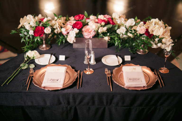 sweetheart table with gold place settings
