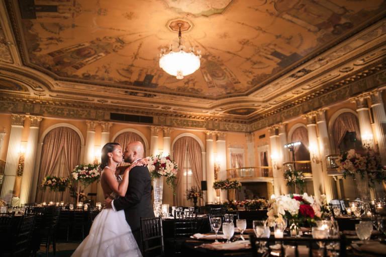 wedding couple kiss at reception