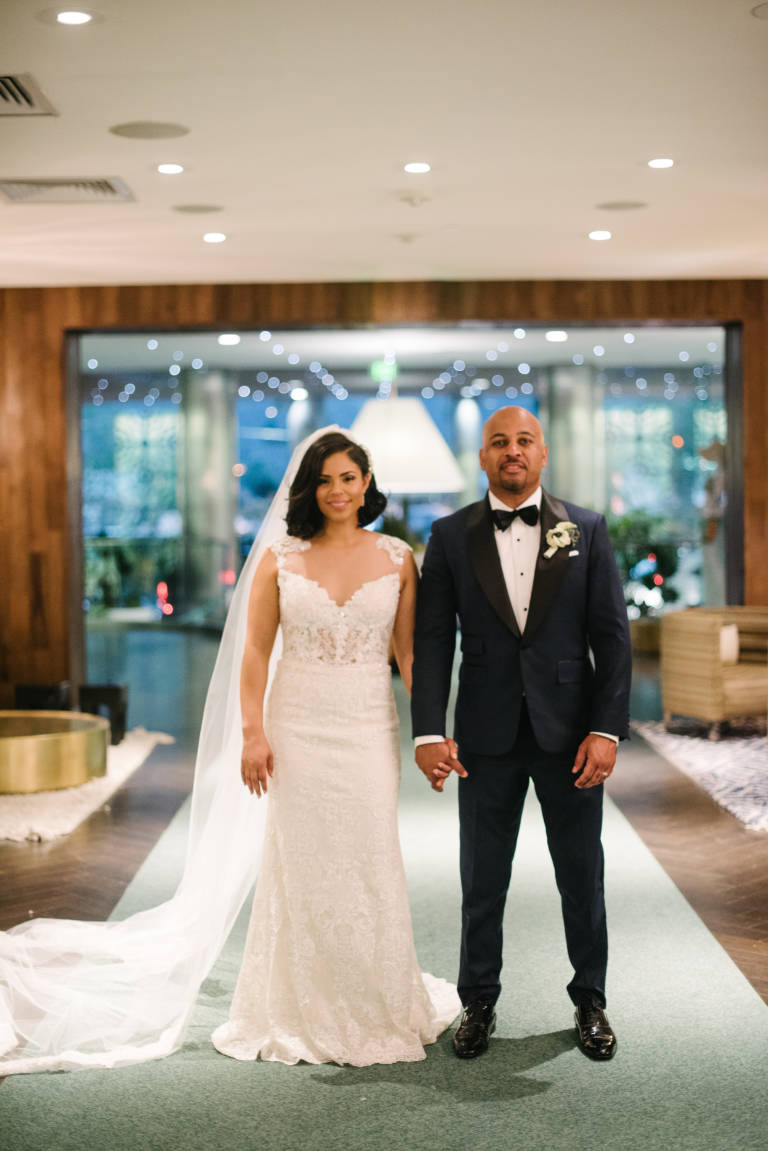 bride and groom in lobby