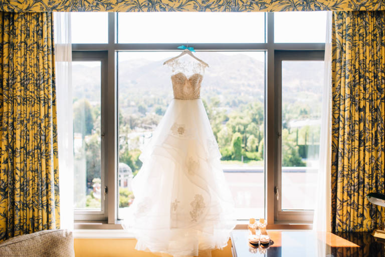 bridal gown hanging in window