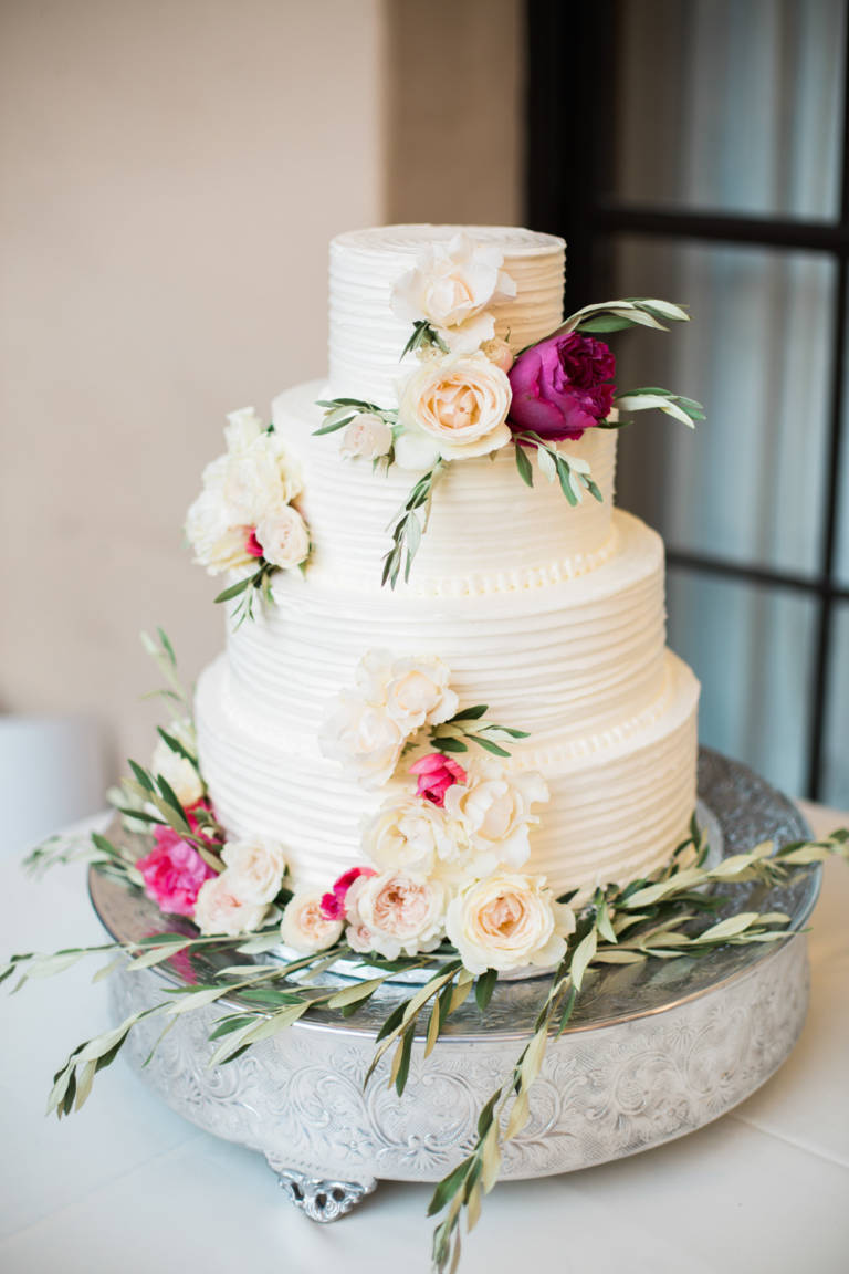 four tier wedding cake with florals