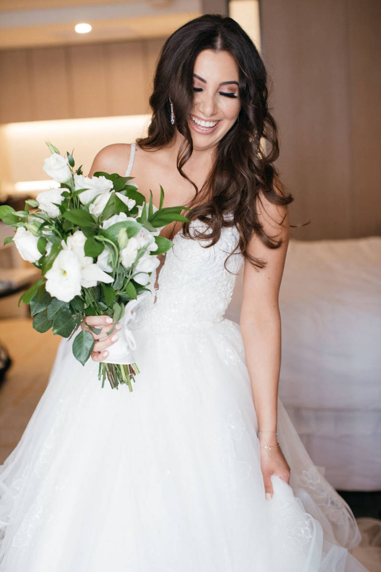 bride smiling with bouquet