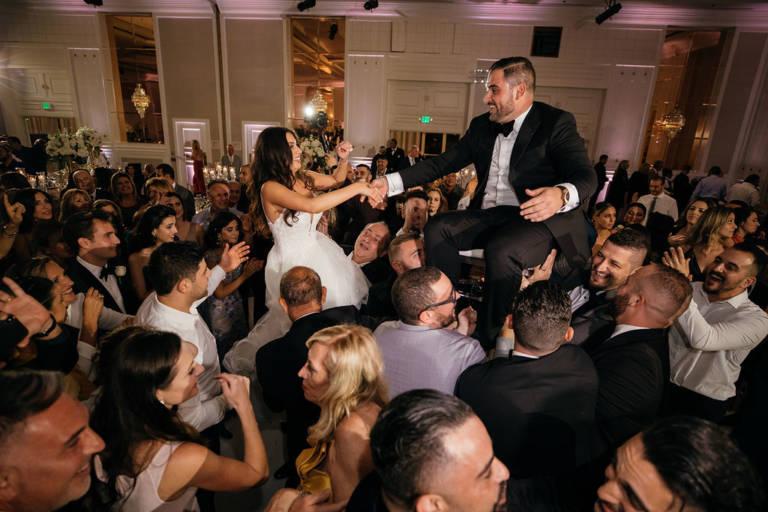 bride and groom dance horah