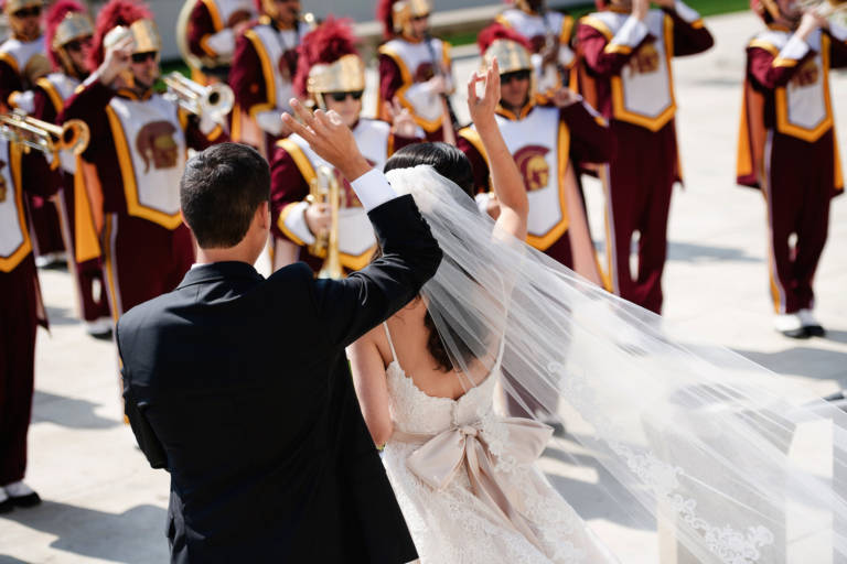 bride and groom with usc band