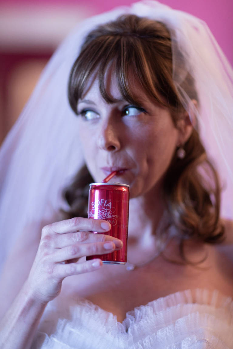bride sipping can of champagne
