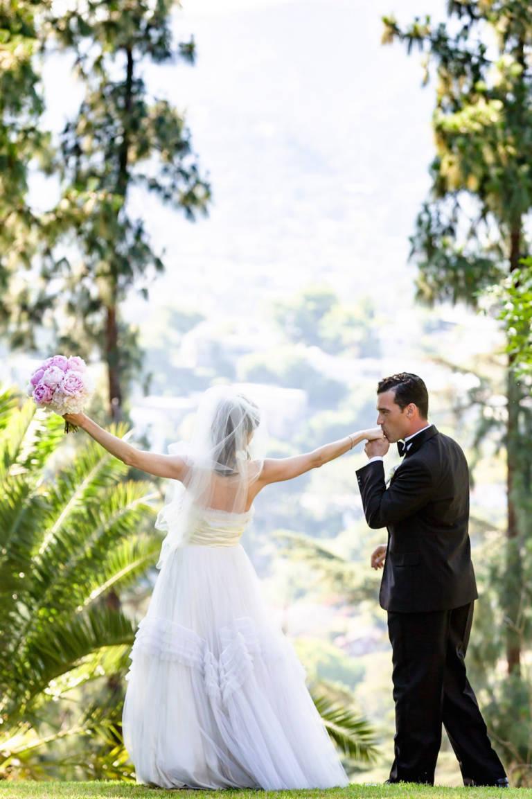 groom kisses bride's hand