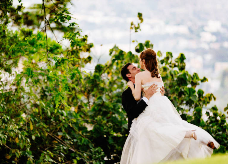 groom lifting bride