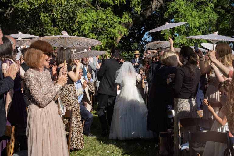 wedding guests with parasols
