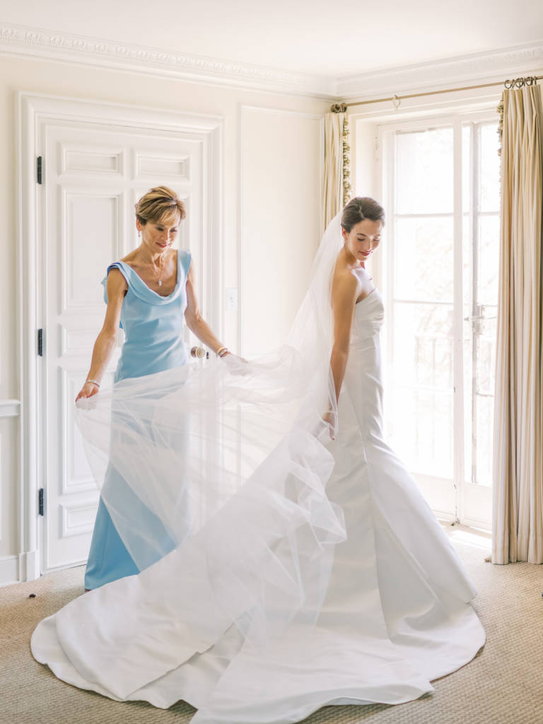 mother of the bride straightens veil