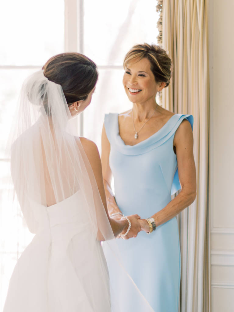 bride and mom smiling