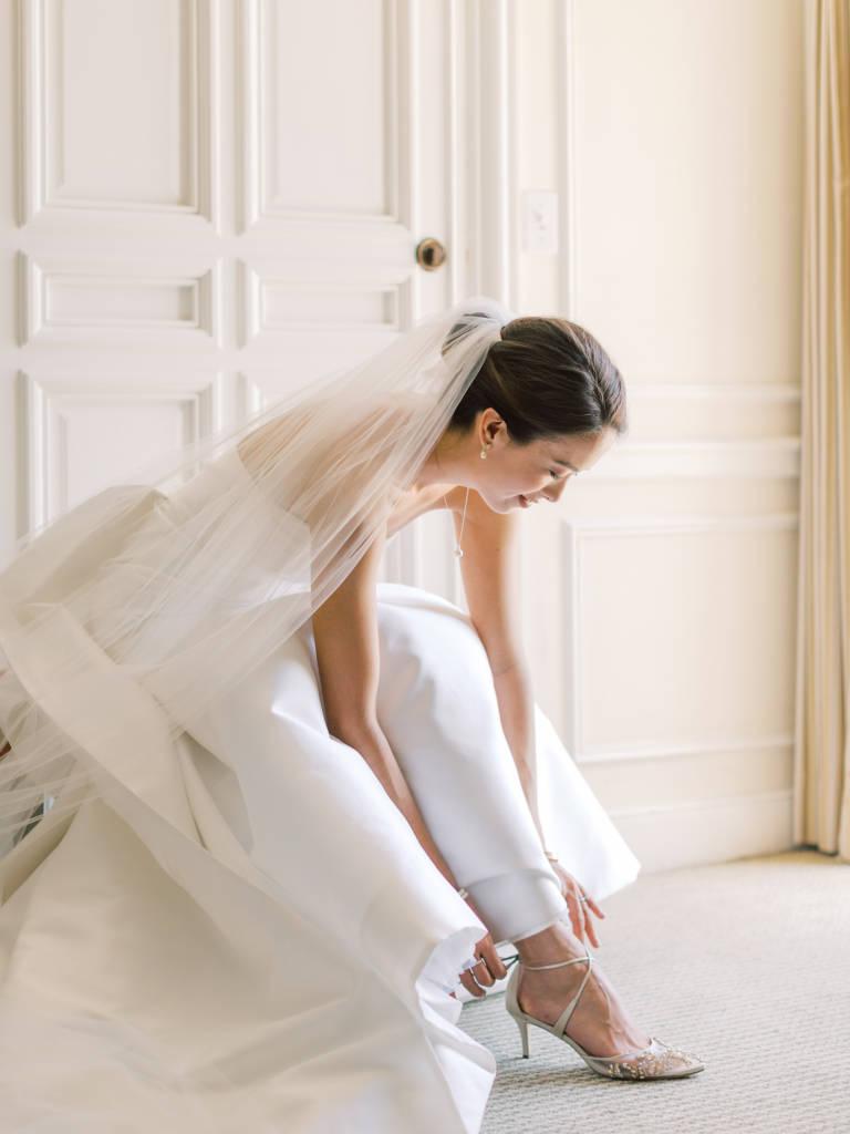 bride fastens shoes