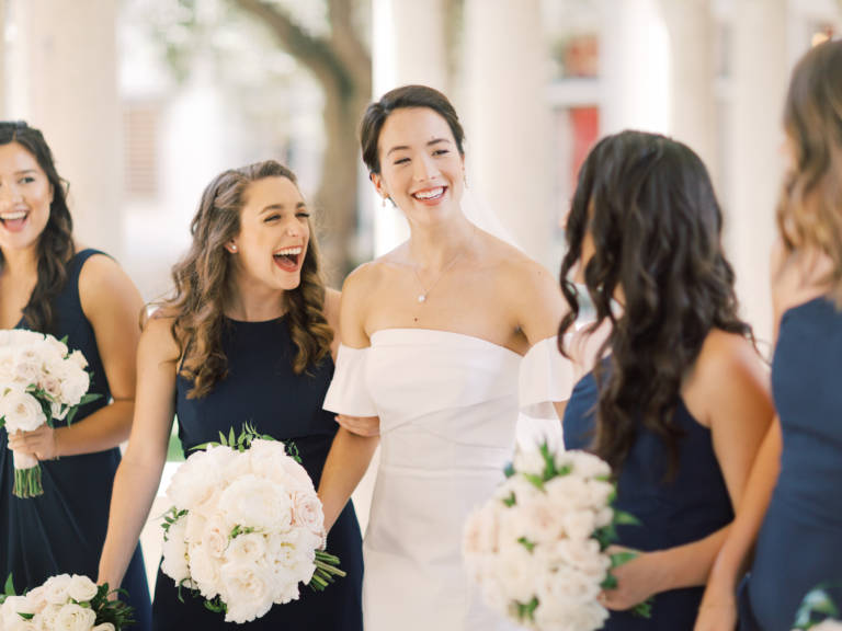 bride and friends laugh
