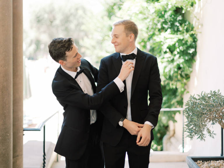 groom straightens tie
