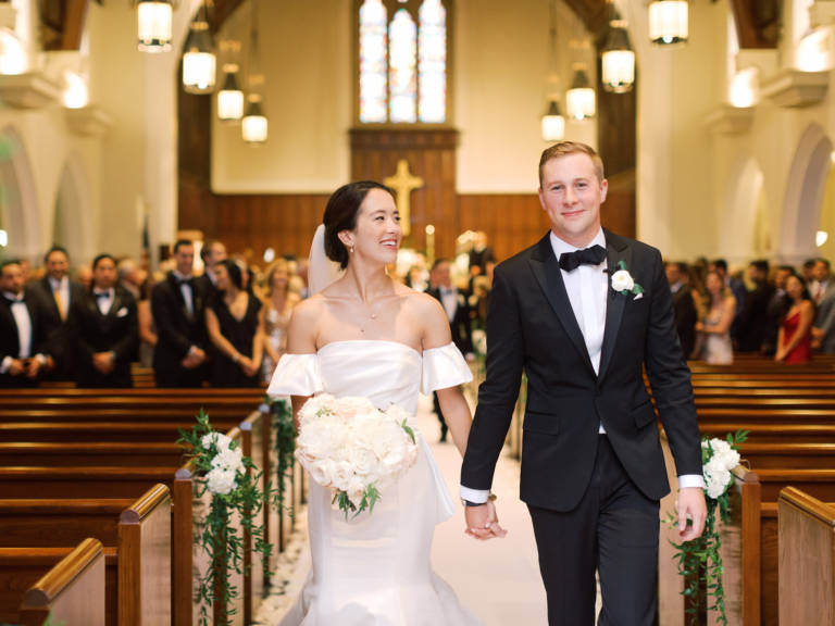 bride and groom in aisle at church
