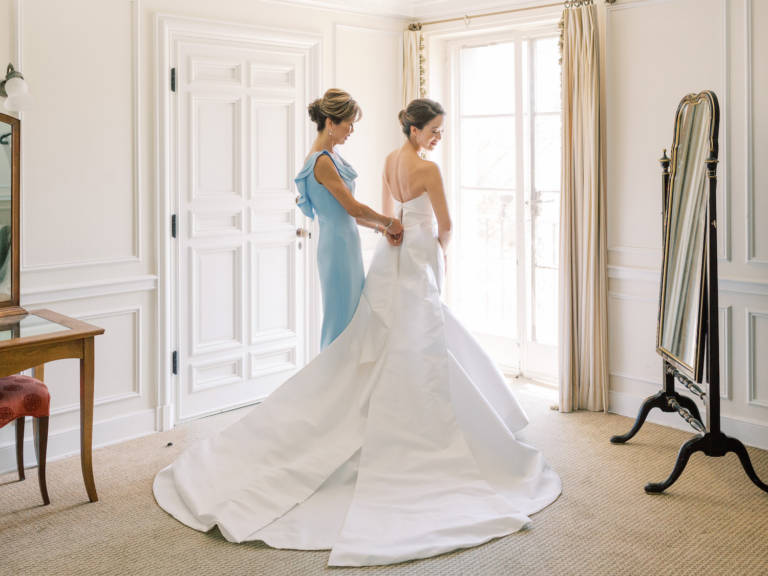 mother of the bride helps get ready