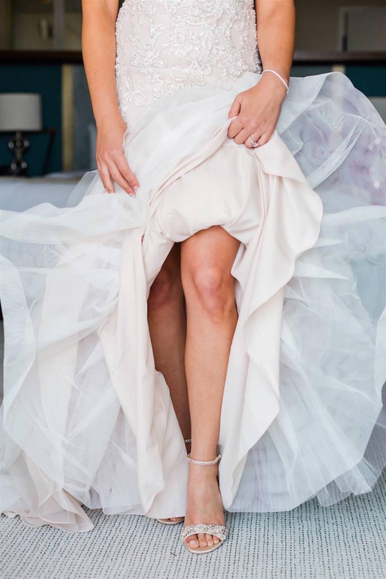 bride shows off shoes