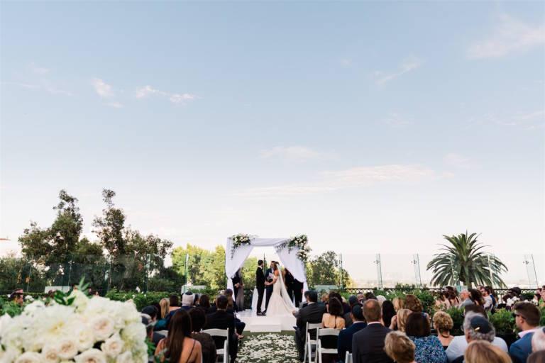 bride and groom rooftop wedding ceremony