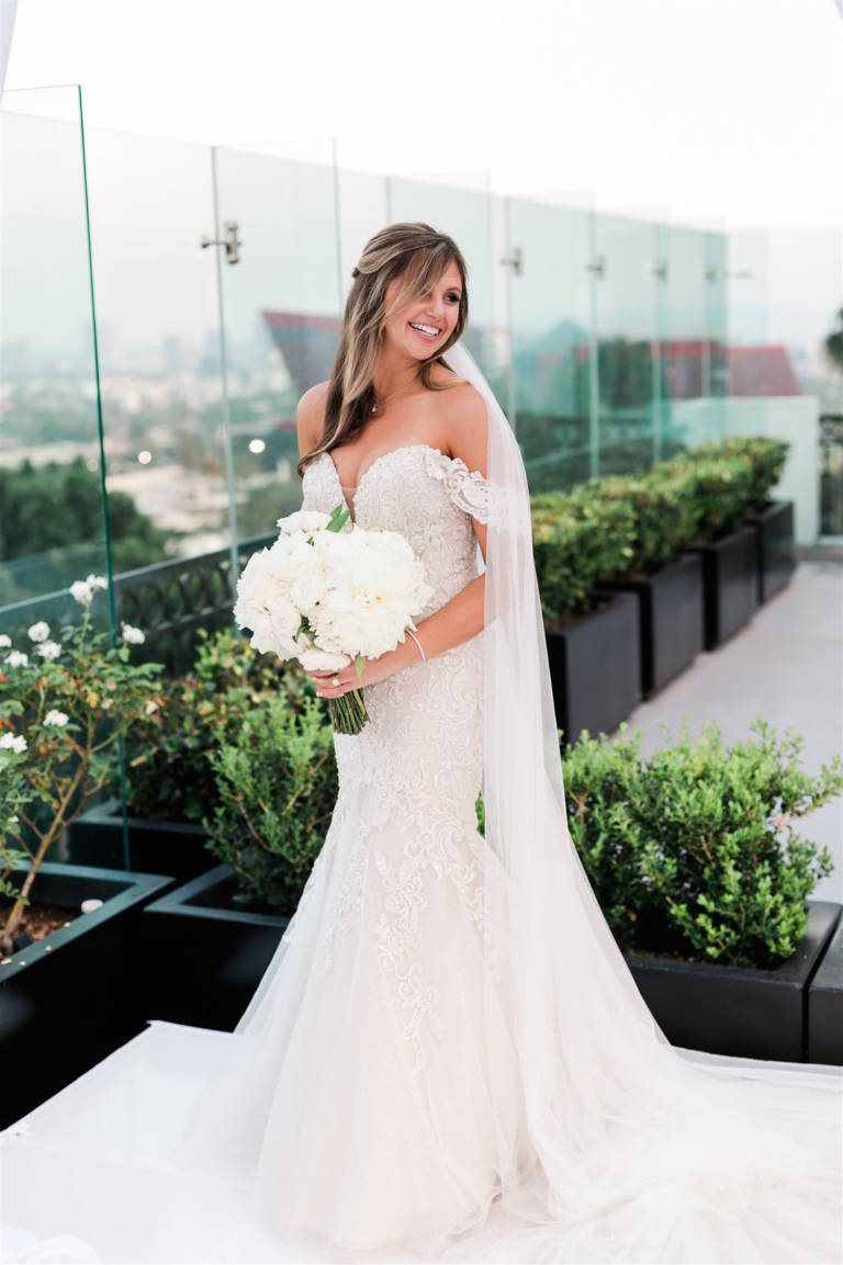 bride in off the shoulder wedding dress
