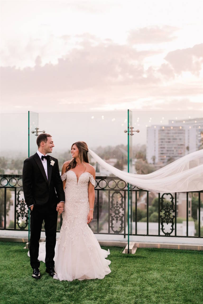 bride and groom on rooftop