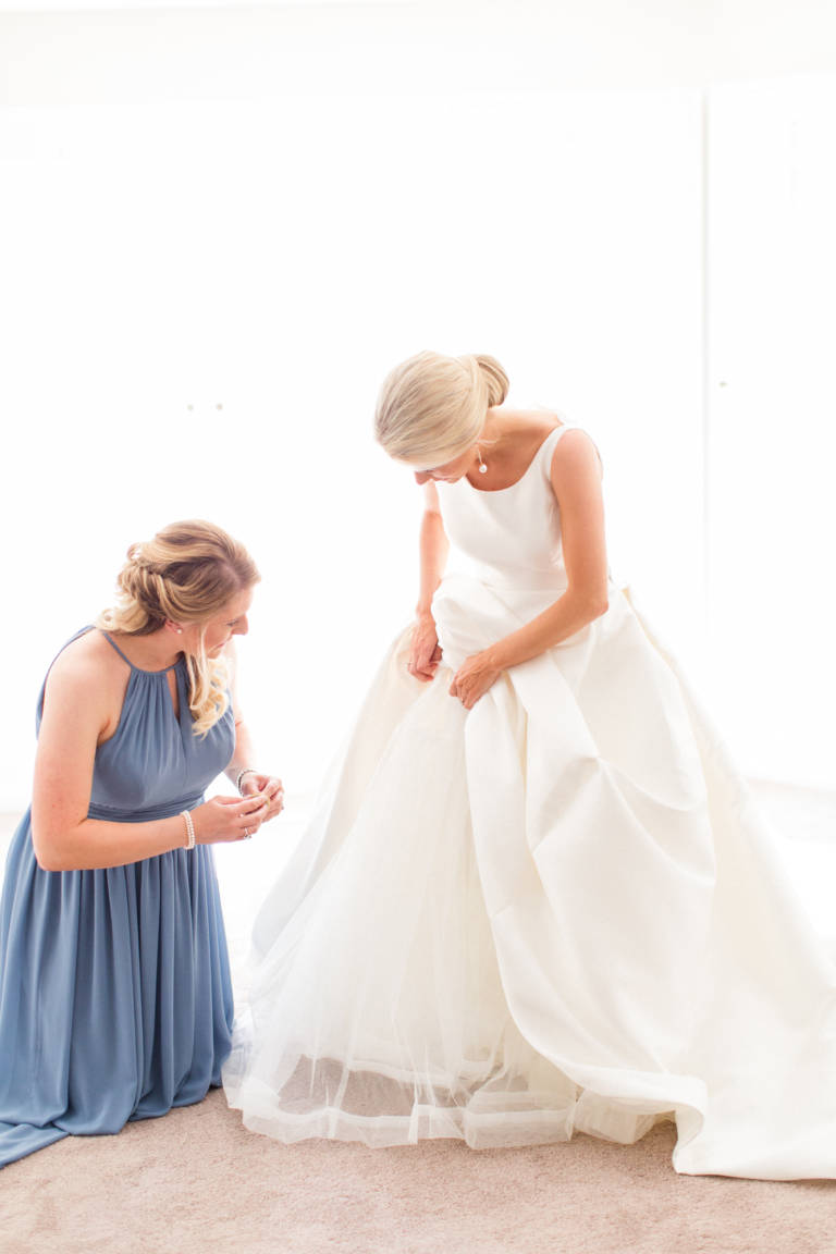 bride getting ready with help