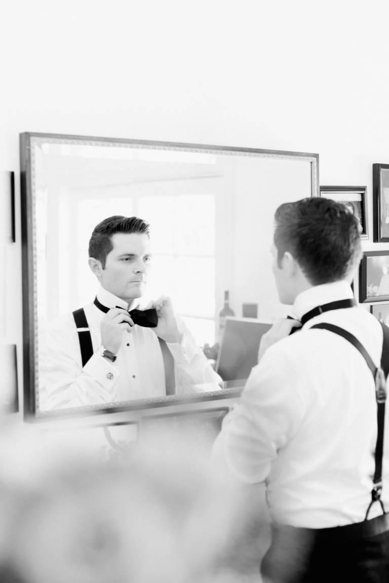 groom ties bowtie