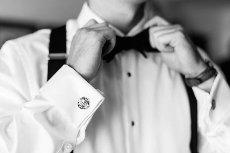 groom fixes bowtie