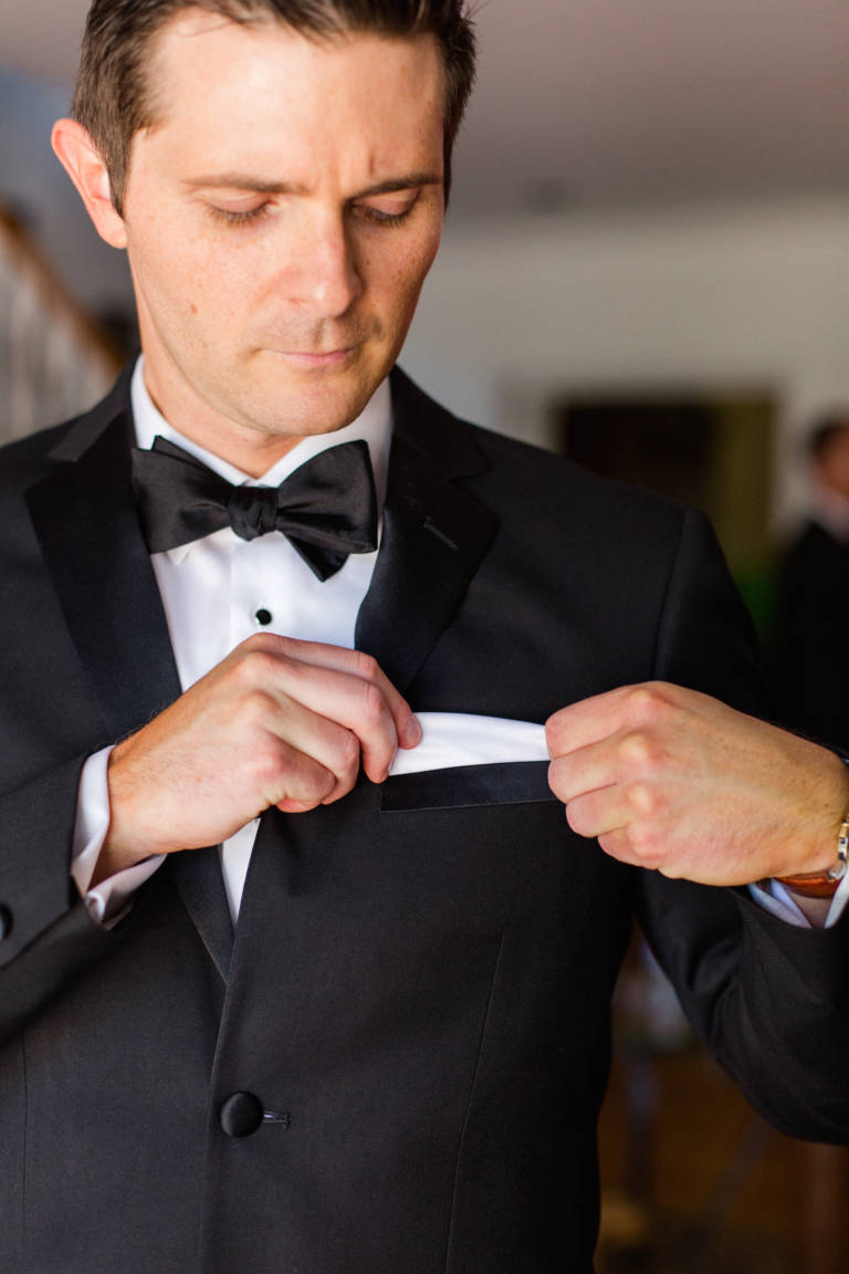 groom fixes pocket square