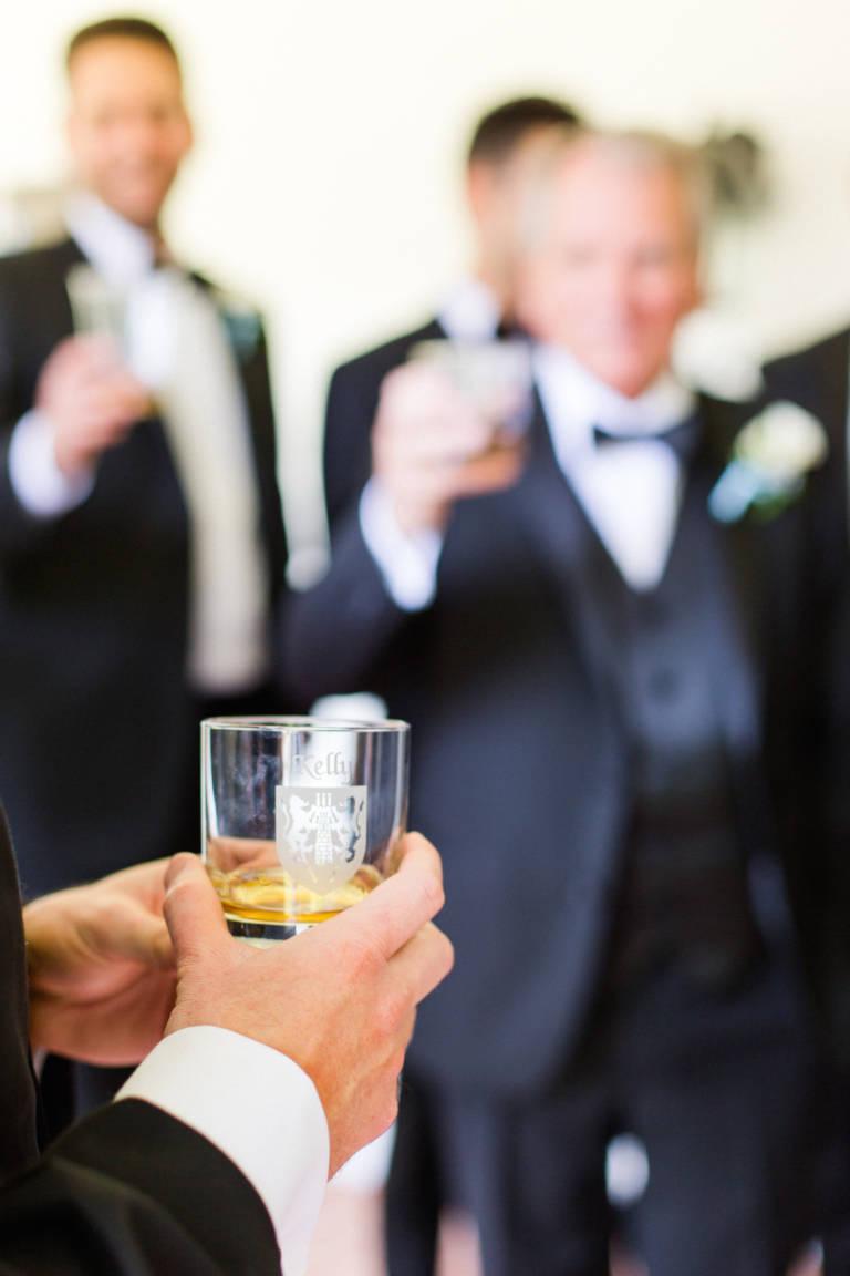 groom holds scotch