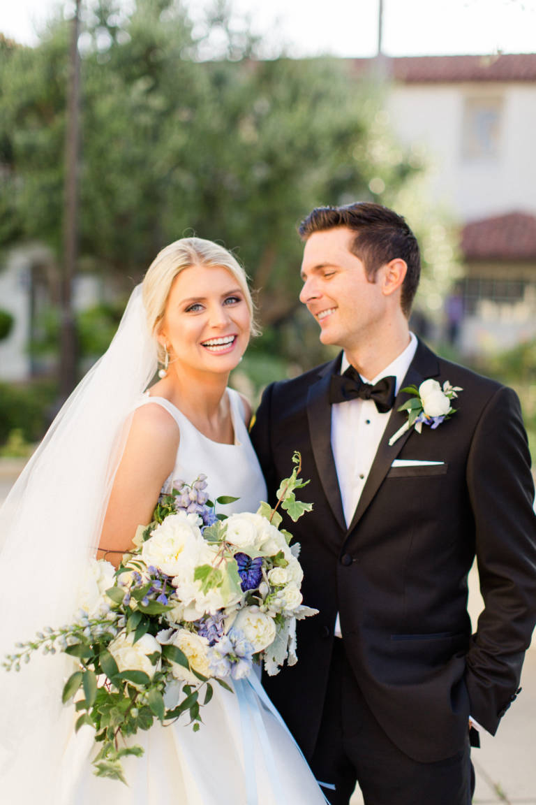 bride and groom smile