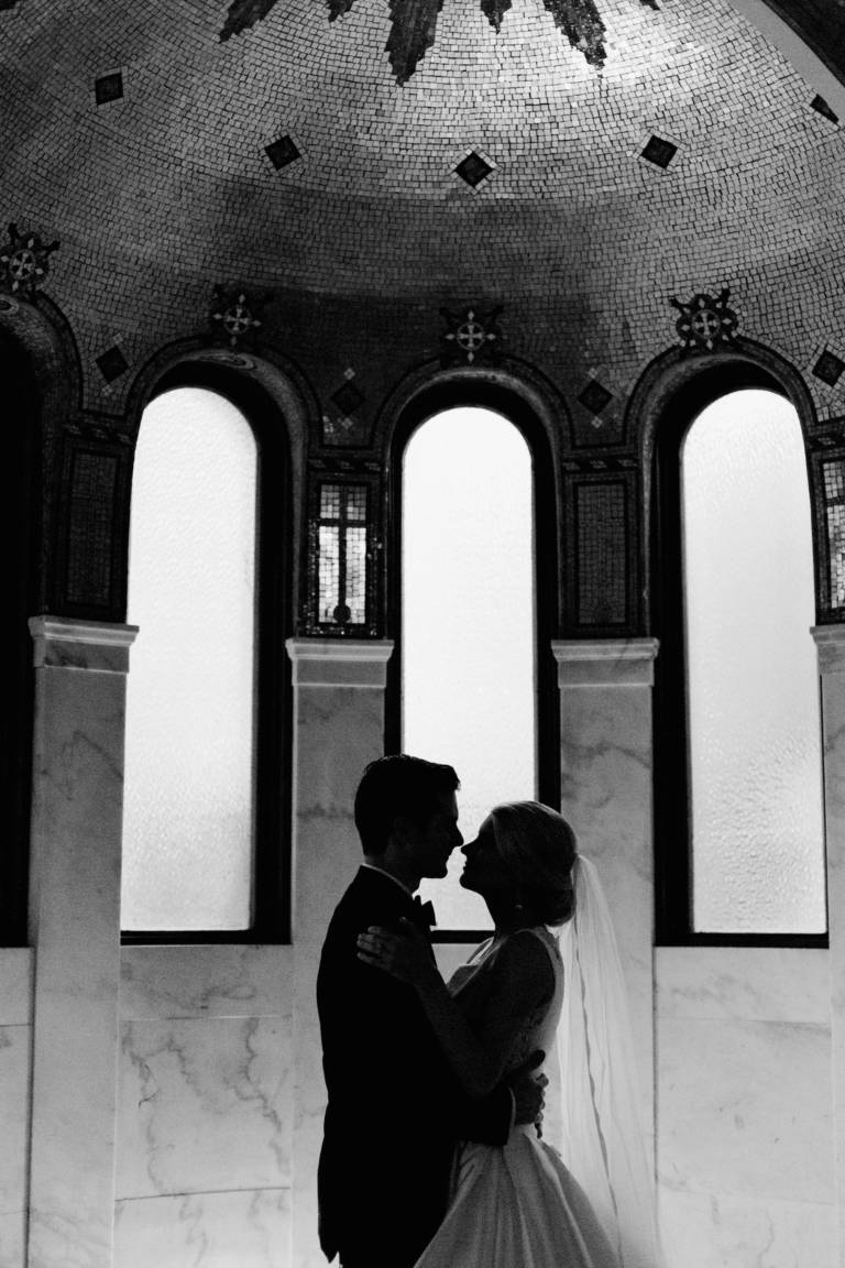 bride and groom in shadow