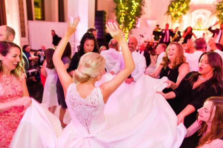 bride dances with friends