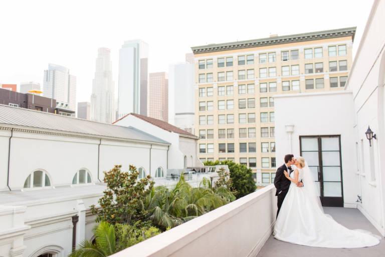 bride and groom kiss at vibiana