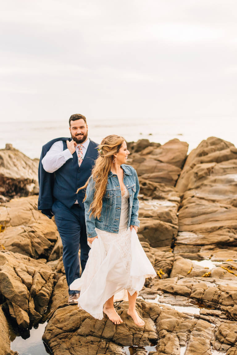 Bride and Groom on Beach Rocks